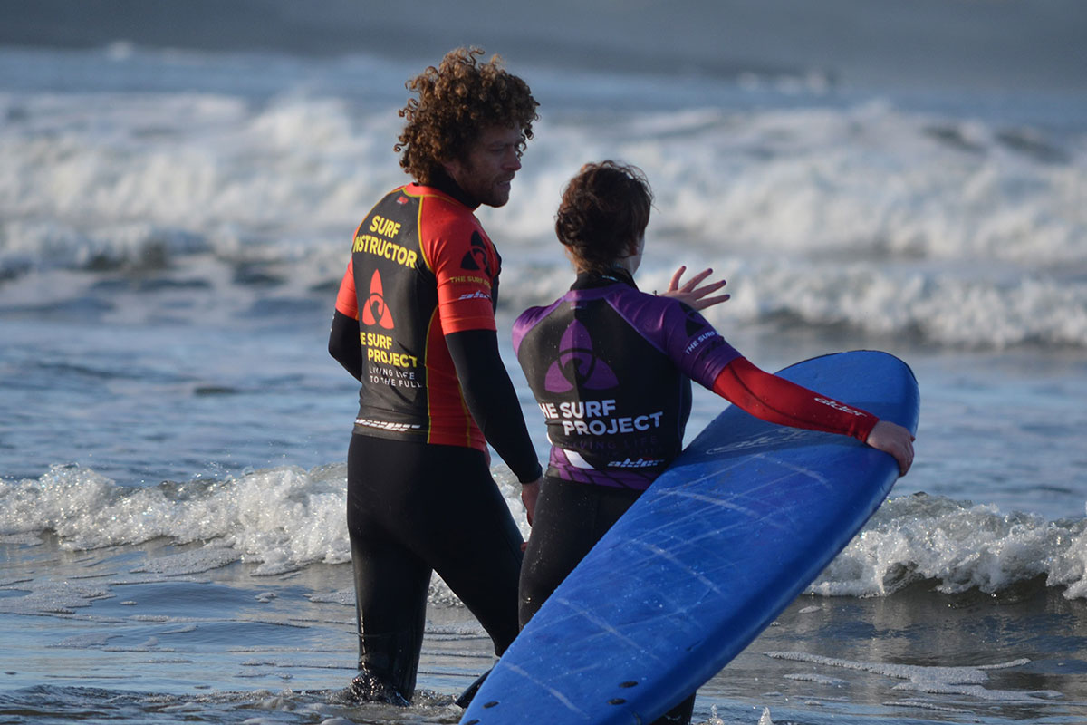 Surf instructor with The Surf Project